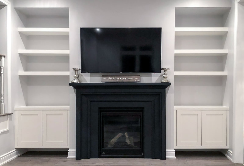 Built-In shelving on both sides of fireplace