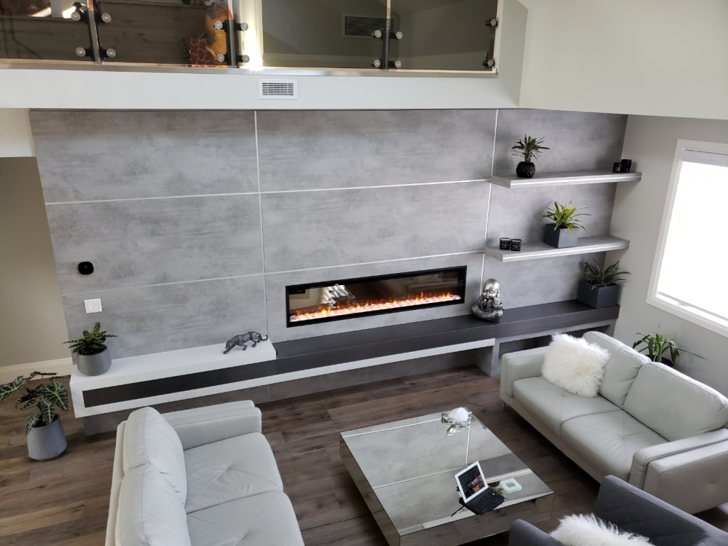 Cement-look wall panels with floating shelves and electric fireplace insert