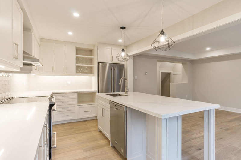 White + Grey Shaker Kitchen With Island Seating